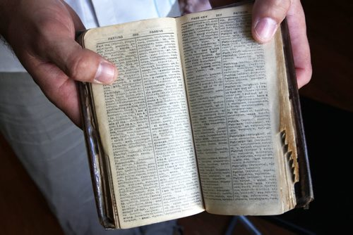 Recent Greek immigrant Stefanos Boukis shows Greek/English translation book his great grandfather used when he came to New York city many years ago -See Carol Sanders Story- July 22, 2014   (JOE BRYKSA / WINNIPEG FREE PRESS) ( Eds Tyler is preparing a small Blippar video of one of their recent concerts)