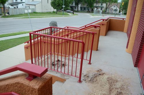 Sand and ashes are scattered at the entrance of the Huasing Buddhist Temple on Cumberland Avnue after the urn that usually adorns the entrance was stolen late Monday night. July 24, 2014. (Oliver Sachgau/ Winnipeg Free Press)