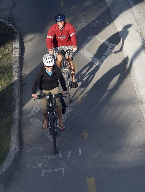 Stdup . Great start for the day expect sun and highs of of + 26 . Cyclists  on Assiniboine Ave at Donald St on a cool morning ride . July 29 2014 / KEN GIGLIOTTI / WINNIPEG FREE PRESS