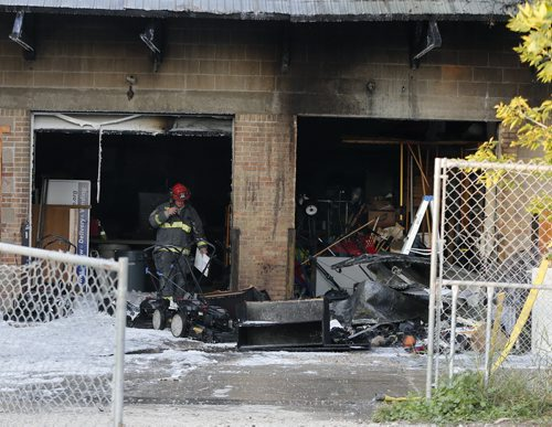 Wpg Fire fighters were kept busy at a fire in the rear loading dock area of Scope International  at 1466 Arlington St at Magnus Ave .Thhe fire is out  and traffic is moving on Arlington Ave although fire crews are still on scene mopping up.  Aug 14 2014 / KEN GIGLIOTTI / WINNIPEG FREE PRESS