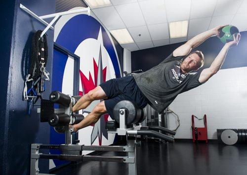 140828 Winnipeg - DAVID LIPNOWSKI / WINNIPEG FREE PRESS  Dr. Craig Slaunwhite works out in the Winnipeg Jets gym Thursday August 28, 2014. Dr. Craig Slaunwhite was hired earlier this month as the Winnipeg Jets director of fitness.   49.8 TRAINING BASKET
