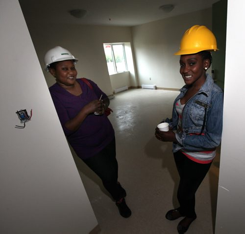 Sisters Doreen Wasuk (left) and Nancy Lado got to inspect their new four bedroom apartment at St. Matthews Anglican Church Thursday. They will be moving in with Doreen's four children. Renovations turning the century old church into an apartment block for low-income housing and a community hub are now completed people are moving into the church in the next weeks. See Brenda Suderman story. September 4, 2014 - (Phil Hossack / Winnipeg Free Press)