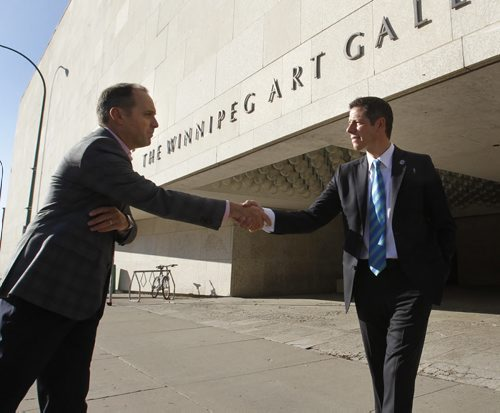 At right, Mayoral Candidate Brian Bowman with Stephen Borys, Director & CEO of the Winnipeg Art Gallery, after Bowman made a policy announcement outside the Winnipeg Art Gallery Friday morning. Aldo Santin story Wayne Glowacki/Winnipeg Free Press Sept.26 2014