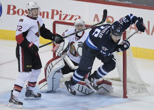 Winnipeg Jets' Blake Wheeler (26) trips over Ottawa Senators goaltender Craig Anderson (41) as he gets checked out of the creese by Aaron Johnson (72) during third period pre-season NHL action in Winnipeg on Monday, September 30, 2014. (John Woods / WINNIPEG FREE PRESS)