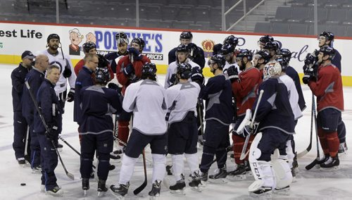Winnipeg Jets head coach Paul Maurice speaks to players after the pre-game skate Tuesday morning in the MTS Centre. The Jets play the Hurricanes at 7P.M. Tuesday night.   Wayne Glowacki / Winnipeg Free Press Oct. 21 2014
