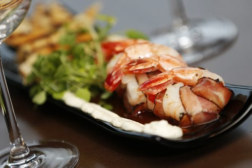 October 28, 2014 - 141028  -  Double Smoked Bacon Wrapped Prawns at Tapastry in the Niakwa Country Club, Tuesday, October 28, 2014. Prawns wrapped in Tyrolean bacon with roasted tomato agro dolce and lemon garlic aioli. Served with grilled flat bread. John Woods / Winnipeg Free Press