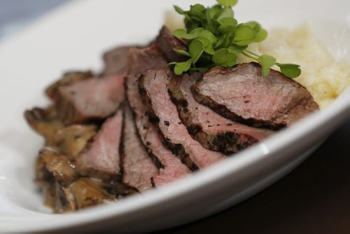 October 28, 2014 - 141028  - Strip Sirloin Steak at Tapastry in the Niakwa Country Club, Tuesday, October 28, 2014. Strip loin steak grilled medium rare and served over asiago mashed potatoes and topped with a herbed wild mushroom ragout. John Woods / Winnipeg Free Press