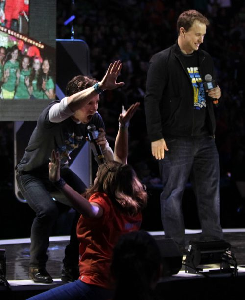 Craig at left  gives the high five to volunteer with Marc Kielburger near the end of the WE Day event in the MTS Centre Wednesday. Nick Martin¤ story. Wayne Glowacki/Winnipeg Free Press Oct.29 ¤ 2014