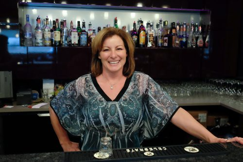 Josette Roch, owner of the Frantz Motor Inn at the restaurant bar. For the most part rural hotel beverage rooms in Manitoba are dying but not the Frantz Motor Inn just south of Steinbach, MB. For years, it had one of the greatest advantages a drinking establishment could have, being on the border of the dry town of Steinbach, MB. However, when Steinbach got its first Liquor Mart in 2008 or so, Frantz biz fell 25 per cent. Still, the Frantz has survived and the owners recently renovated the restaurant and are making plans to renovate the hotel bar. 141104 - Tuesday, November 04, 2014 -  (MIKE DEAL / WINNIPEG FREE PRESS)