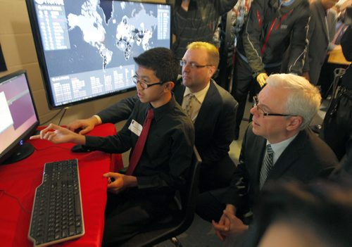 Education and Advanced Learning Minister Peter Bjornson and Premier Greg Selinger watch Sisler student Deven San Miguel demonstrate cyber attack monitoring in the lab at the school. Expansion of Sisler's cyber security academy, giving more students access to some of the most advanced learning opportunities in Canada. BORIS MINKEVICH / WINNIPEG FREE PRESS November 13, 2014