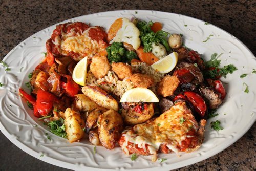 The Sorrentos family shows off their dinner for two at their location at 529 Ellice Ave in downtown Winnipeg –- See Marion Warhaft review– Nov 18, 2014   (JOE BRYKSA / WINNIPEG FREE PRESS)