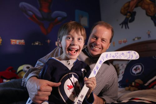 Eight year old Connor McDaniel is on cloud nine and can't stop smiling since receiving a autographed Jets hockey stick from Mark Scheifele after game Tuesday night.  His dad Chad was with him at the game when he received it.    Nov 19,  2014 Ruth Bonneville / Winnipeg Free Press