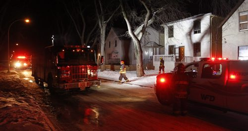 Winnipeg Fire crews arrived at a fire in a two storey house at 499 Pritchard Ave. at 5A.M. Thursday morning. The five adults and 4 children safely evacuated and no one was injured. The cause is under investigation.  Wayne Glowacki / Winnipeg Free Press Dec.4  2014