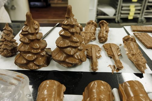 moulded chocolate made in the shop ready for trimming.Sunday This City - Chocolatier Constance Popp .** note last name is different from company name.  Chocolatier Constance Popp, 180 Provencher Blvd. -  Constance Menzies  for a Sunday This City spread on Menzies's St Boniface chocolate shop - a spot that has made a name for itself during the last 7 years, for its treats and creative designs, when it comes to chocolate. Christmas goodies available - chocolate in all shapes of trees, nutcrackers, etc - as well as a shot of Menzie's Human Rights Museum made out of chocolate - a creation that blew the museum's architect away, when Menzies presented him with one a few months Dec. 11 2014 / KEN GIGLIOTTI / WINNIPEG FREE PRESS