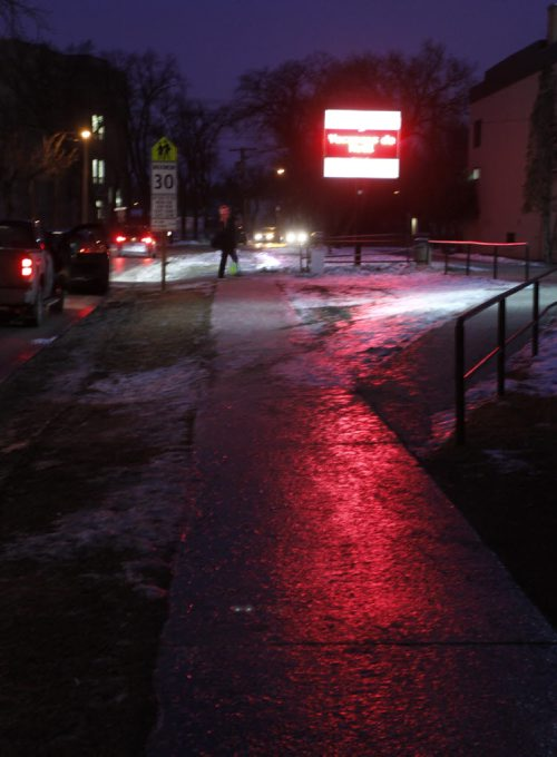 Icy sidewalk on Rue St. Jean Baptiste Monday morning as temperatures drop after the mild weekend weather. Wayne Glowacki / Winnipeg Free Press Dec.15 2014