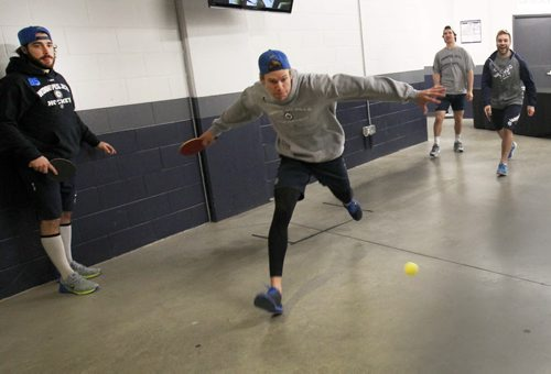 Keeping it Light- Winnipeg Jets L to r Mathieu Perreault, Paul Postma , Jim Slater, and Grant Clitsome keep it light Tuesday morning before practice with a game of ping pong in the halls of the MTS Centre- The Jets are in preparation for a home game tonight against the Buffalo Sabers- Standup photo – Dec 16, 2014   (JOE BRYKSA / WINNIPEG FREE PRESS)