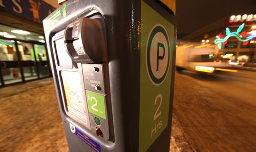 Photo illustration of parking meter for story on proposal for new paid parking during the evening hours in downtown Winnipeg.  Photo taken on Portage Ave. See Randy's story.  Jan 16, 2015 Ruth Bonneville / Winnipeg Free Press