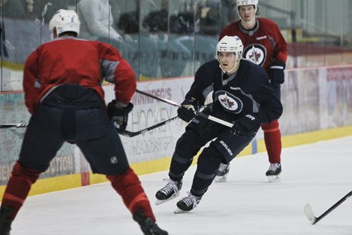 Winnipeg Jets' Mark Scheifele (55) chases after the puck during practice at the MTS IcePlex Tuesday morning.  150120 January 20, 2015 Mike Deal / Winnipeg Free Press