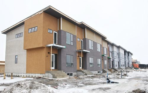 Construction continues in the new Waterford Green housing development.  Waterford Green is a new housing development located off Keewatin Street between Inkster Boulevard and Jefferson Avenue. 150128 January 28, 2015 Mike Deal / Winnipeg Free Press
