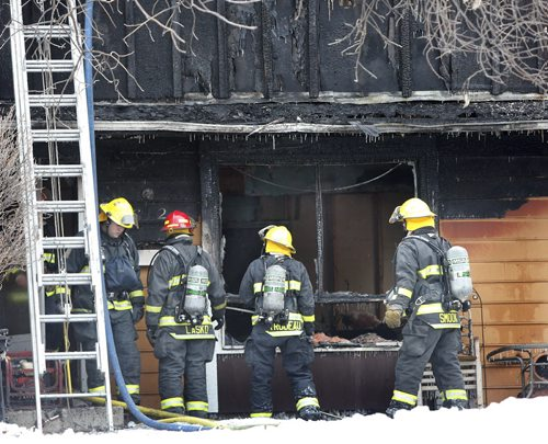 Winnipeg Fire Fighters at the scene of a townhouse fire at 1736 St. Mary's Rd. The fire was contained to one unit but it is a total lose. No one was in the unit when fire crews  arrived, two cats and two dogs may have perished they have not been found . Wayne Glowacki/Winnipeg Free Press Jan. 30 2015
