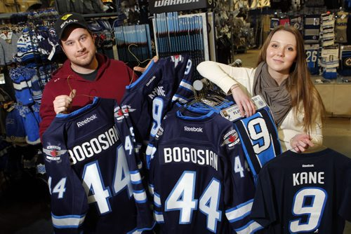SPORTS - Royal Sports employees Casey Bresch and Taylor Keane pose with some Zach Bogosian and Evander Kane wear that is coincidently on sale at the Pembina Highway store. BORIS MINKEVICH / WINNIPEG FREE PRESS  FEB. 11, 2015