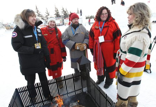 Festival Du Voyageur board members L to R Natalie Thiesen, Lynne Connelly, Simon Normandeau, and Lisa Cupples welcome Shelly Glover –Minister of Canadian Heritage and and Official Languages to newsconference today at the Festival site- Western Canada's largest winter festival - the 2015 Festival du Voyageur - runs from February 13 – 22. –See Alex Paul Story- Feb 12, 2015   (JOE BRYKSA / WINNIPEG FREE PRESS)