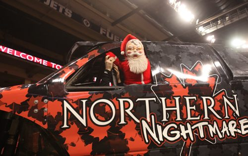 Free Press  columnist Doug Speirs has his scary Santa try driving Monster Truck driver, Cam McQueen's Northern Nightmare Truck on Friday.  See Speirs column   Standup photo Feb 20, 2015 Ruth Bonneville / Winnipeg Free Press