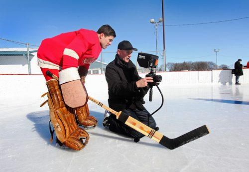"""Director, Danny Schur and actor, MarkianTarasiuk, recreate Detroit Red Wings goalieTerry Sawchuk's iconic 1948 pose on-ice at the  Riverview Community Centre on Tuesday for a film they are shooting on  Sawchuk's life. Standup photo.  Feb 24, 2015 Ruth Bonneville / Winnipeg Free Press  More info: Drafted by the Detroit Red Wings at the age of fourteen, the tough-as-nails North-Ender guarded the crease for twenty-one NHL seasons, playing in the no-mask era for Detroit, Boston, Toronto, New York and Los Angeles.  But his formative story - the strict, religious Ukrainian household on Aberdeen, the revolutionary """"Sawchuk Crouch"""" concocted by his older brother, Mitch, his unbending left elbow (the result of an injury he hid from disapproving parents) - is the exclusive product of North End Winnipeg of the 1930's and '40's. Film is to be completed by the start of the hockey season in Sept 2015 and will be debuted in the Sawchuk arena."""