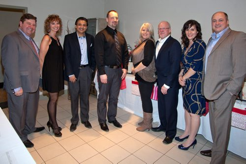 The Deer Lodge Centre Foundation held its 10th annual fundraising Bella Notte Dinner at DeLuca's Banquet Centre on Feb. 13, 2015. Pictured, from left, are Gordon Fardoe, Susan Fardoe, Winston Maharaj, Paavo Ryynanen, Jacquie Lenz, Paul Challoner, Laurie Cerqueti and Tony Cerqueti. (JOHN JOHNSTON / WINNIPEG FREE PRESS)