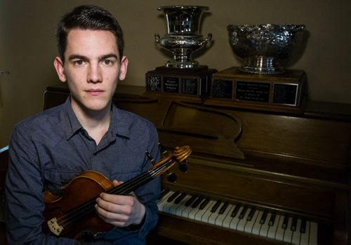 Gregory Lewis winner of the Aikins Memorial Trophy at his home the day after winning the Music Festival award. 150315 - Sunday, March 15, 2015 -  (MIKE DEAL / WINNIPEG FREE PRESS)