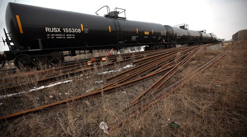 CP Rail yards in the city center and a train made up of oil tanker cars flowing through the city center. See story. March 27, 2015 - (Phil Hossack / Winnipeg Free Press)