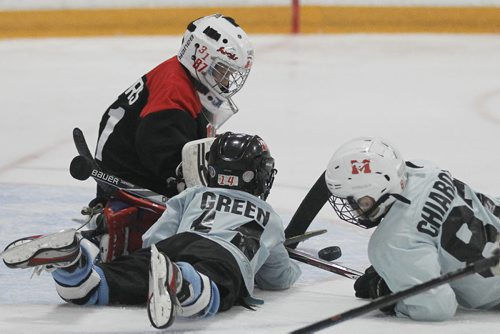 March 30, 2015 - 150330  -  A goaltender make the save at a spring hockey camp Gateway Arena Monday, March 30, 2015. A recent study shows that hockey helmets are not good at protecting against concussions. John Woods / Winnipeg Free Press