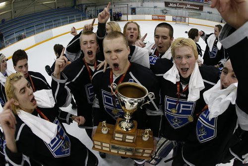 March 16, 2015 - 150316  -  Oak Park Raiders celebrate a win over the St Paul's Crusaders in the AAAA High School Hockey Championship game at St James Civic Centre  Monday, March 16, 2015. John Woods / Winnipeg Free Press