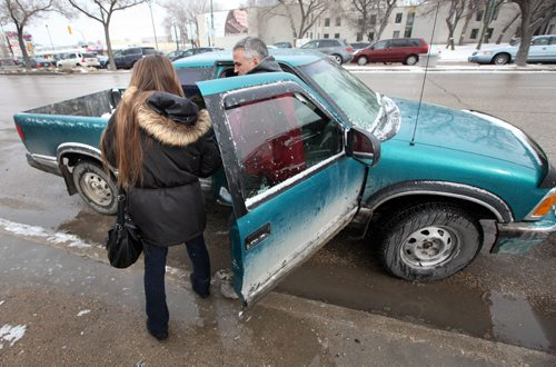 **** (left) stops a stranger getting out of his truck as she walks north main to show a photograph and ask passers by if they've seen her daughter **** as she searches the north end for her missing 14-year-old. See Gord Sinclair's story. April2, 2015 - (Phil Hossack / Winnipeg Free Press) ***NOTE!! WE CANNOT ID ANY OF THESE WOMEN AT THIS POINT. THE PHOTOS HERE WITH FACES SHOWING ARE TO BE USED ONLY WITH AUTHORIZATION FROM MIKE APORIOUS.***