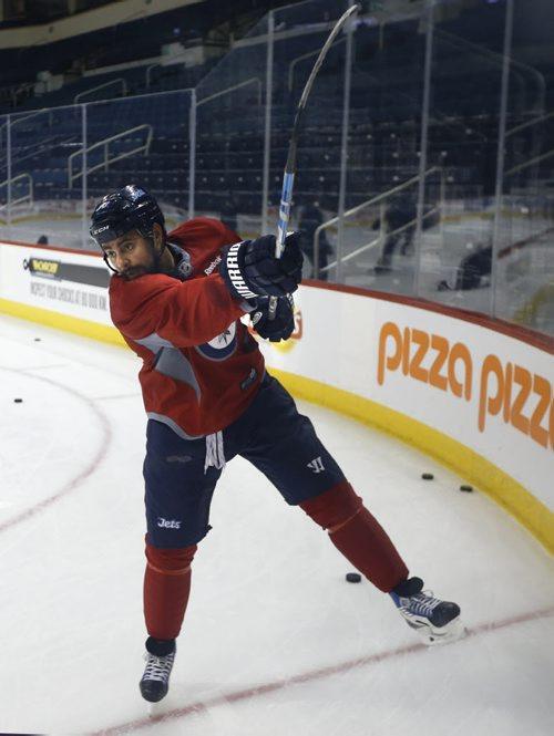 Winnipeg Jets Dustin Byfuglien skates with a handful Jets players Friday afternoon. Tim Campbell story. Wayne Glowacki/Winnipeg Free Press April 10 2015