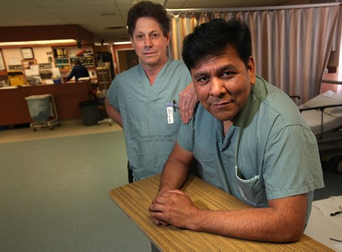 "Orthopedic surgeon Dr David Hedden (left) poses with Manuel Fonseca, formerly a physician in Managua Nicaragua who now lives and works in Winnipeg at a Senior Care Home. Manuel has become part of the ""Operation Walk"" team headed by Hedden which travels to Managua to do joint replacements annually. See Geoff Kirbyson story. (April 10, 2015 - (Phil Hossack / Winnipeg Free Press)"