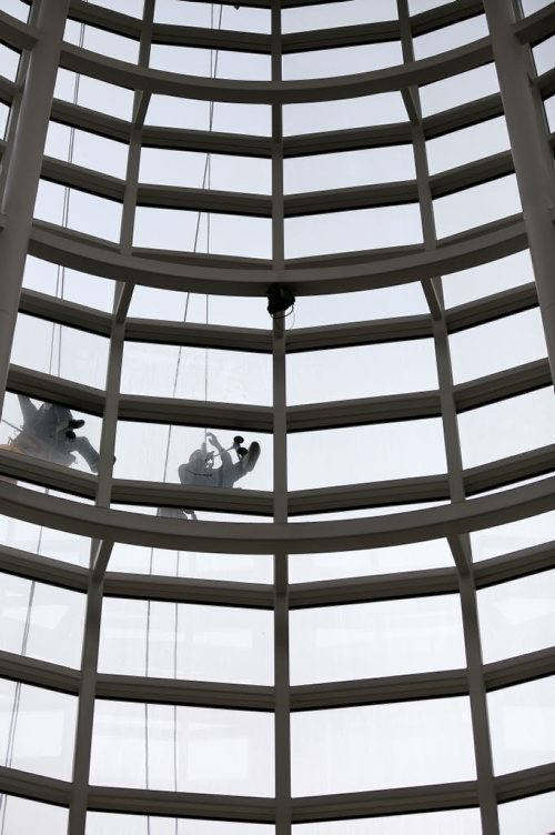 Window washers preparing MTS Centre after the Winnipe Jets' regular season completed Saturday afternoon against the Calgary Flames, Sunday, April 12, 2015. The Jets' first playoff game goes April 16 and the first home game will be next Monday. (TREVOR HAGAN/WINNIPEG FREE PRESS)