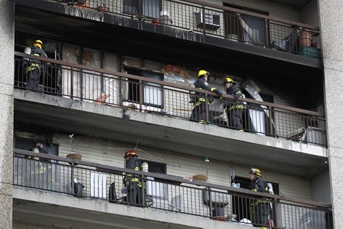 April 12, 2015 - 150412  -  Firefighters attend a fire on an apartment balcony at 429 Westwood Sunday, April 12, 2015. John Woods / Winnipeg Free Press