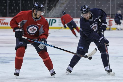 Winnipeg Jets' Toby Enstrom (39) and Bryan Little (18) during the morning pre-game skate at MTS Centre. The Jets will face-off against the Anaheim Ducks in the fourth game of their Stanley Cup playoff series tonight.   150422 April 22, 2015 Mike Deal / Winnipeg Free Press