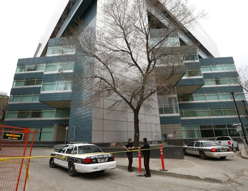 Winnipeg Police at the taped off scene Monday morning in a lot off of Hargrave St. behind the Air Canada building. Police said Sunday the body of a man in his late 60s had been found in the east lane of 329 Hargrave St. on Saturday at about 12:45 a.m., and the body of a man in his late 40s was discovered behind 333 Portage Ave. at about 6:30 p.m. Wayne Glowacki / Winnipeg Free Press April 27 2015