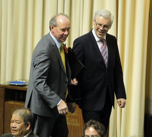 Manitoba's new finance minister, Greg Dewar, presents his first budget in Winnipeg on Thursday afternoon. Here he, left, is greeted by Premier Greg Selinger. BORIS MINKEVICH/WINNIPEG FREE PRESS APRIL 30, 2015