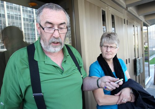 """""""Can Not Bring My Daughter Back """"Father Art Wiebe and mother Mary Ann Wiebe of Kendall Wiebe, 27,  a woman who  working inside a hair salon in St James in April 2012 that was killed by Adebola Shoyoye, not pictured, after he drove his SUV through Crestview Shopping Centre comments on  sentence to Shoyoye- He was sentenced to  90 days in jail -- served on weekends -- after being sentenced today for  dangerous driving that caused the death -See Kevin Rollason story- Apr 30, 2015   (JOE BRYKSA / WINNIPEG FREE PRESS)"""