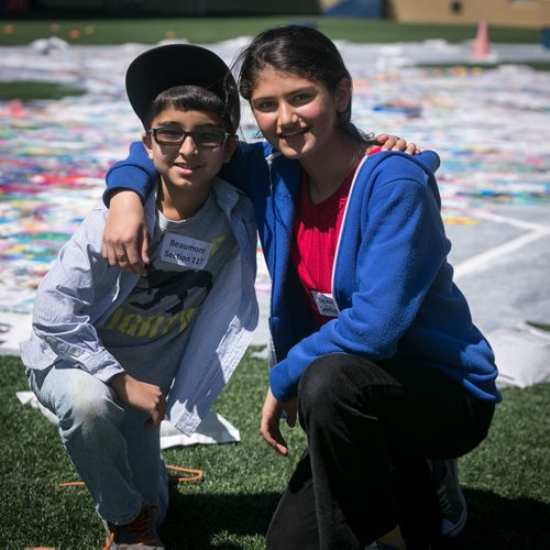 Urooba Salar, Grade 6 student at Beaumont Elementary School, poses with her brother and Grade 3 student Zaryab, in front of the panels their school that for, the Human Rights Logo - an art installation highlighting children's human rights at Investors Group Field.  150520 - Wednesday, May 20, 2015 - (Melissa Tait / Winnipeg Free Press)