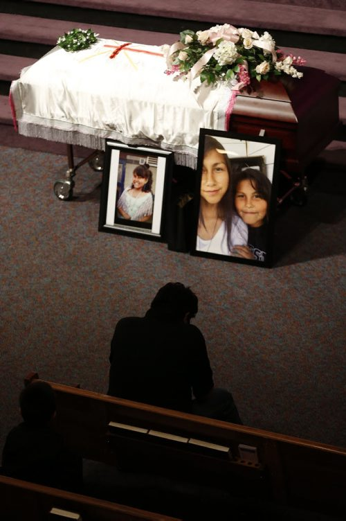 May 25, 2015 - 150525  -  A family friend sits before the casket of Teresa Robinson prior to a memorial service. Friends and family came together to celebrate the life of Teresa Robinson at Calvary Temple Monday, May 25, 2015. John Woods / Winnipeg Free Press