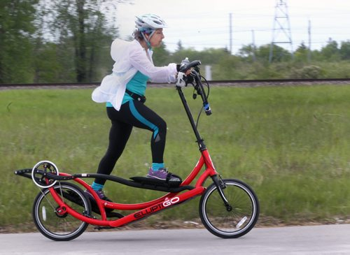On the Move- A cyclist whips by on Taylor Ave in Winnipeg riding a unique machine crossed between an elliptical exercise machine and a traditional bicycle-Standup Photo- June 01, 2015   (JOE BRYKSA / WINNIPEG FREE PRESS)