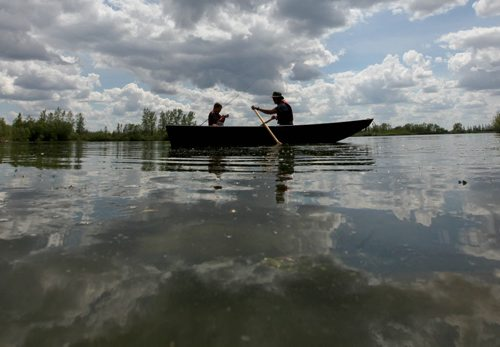 Colin Flemington and his son James decide to start off the weekend early by going fishing together at Fort Whyte Friday afternoon.  James, who is home schooled,  finished his work early allowing time away with dad to enjoy the warm weather.   Standup photo   June 05, 2015 Ruth Bonneville / Winnipeg Free Press