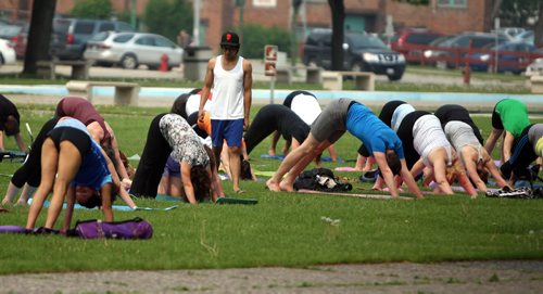 Yoga time in Memorial Park. Free Fitness in the park program. Every Monday, Wednesday, and Friday at noon until 12:45, June 1 until August 28 there will be free outdoor yoga classes held in Memorial Park (Monday and Friday class) and Millennium Library Park (Wednesday class). - See more at: http://downtownwinnipegbiz.com/programs-services/events/fitness-in-the-park/#sthash.hGVdk3Ja.dpuf   BORIS MINKEVICH/WINNIPEG FREE PRESS June 8, 2015