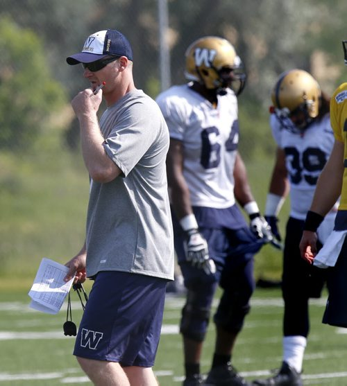 Head Coach Mike O'Shea,left,  at the Winnipeg Blue Bomber camp Friday.  Paul Wiecek story Wayne Glowacki / Winnipeg Free Press June 12 2015