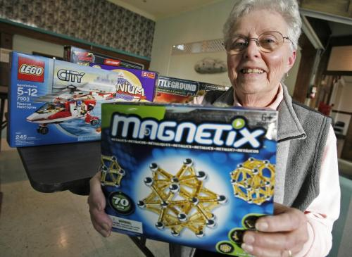 John Woods / Winnipeg Free Press / November 17/07- 071117  -  Bev Ridd, board member of Project Peacemakers, displays some toys which they approve of for this  Christmas season.  Photographed in Project Peacemakers office Saturday Nov 17/07.