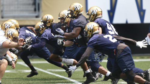 Bryant Turner Jr. #92 DT (in the centre of picture, his helmet shows #92 and is nearest to the top of the picture) at the   Winnipeg Blue Bomber practice at the Investors Group Field Monday. Tim Campbell / Scott Billeck .Wayne Glowacki / Winnipeg Free Press June 29  2015